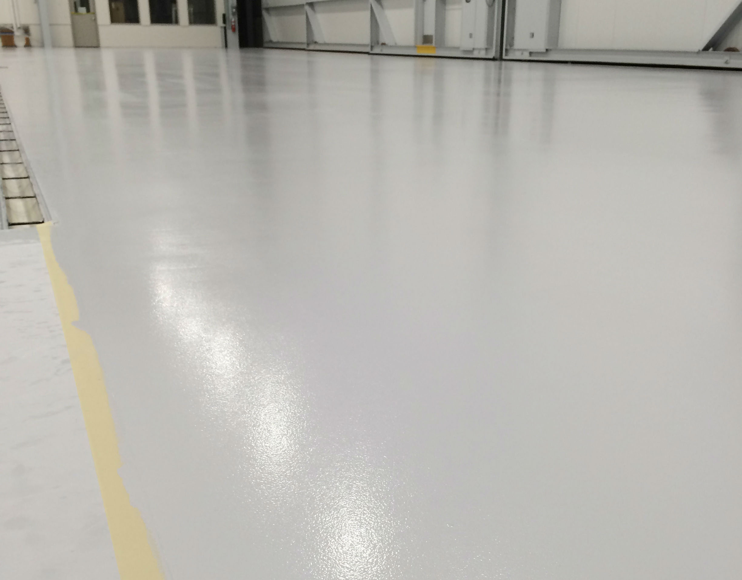 Applied flooring gives corporate hangar an aesthetic for Polished concrete floors